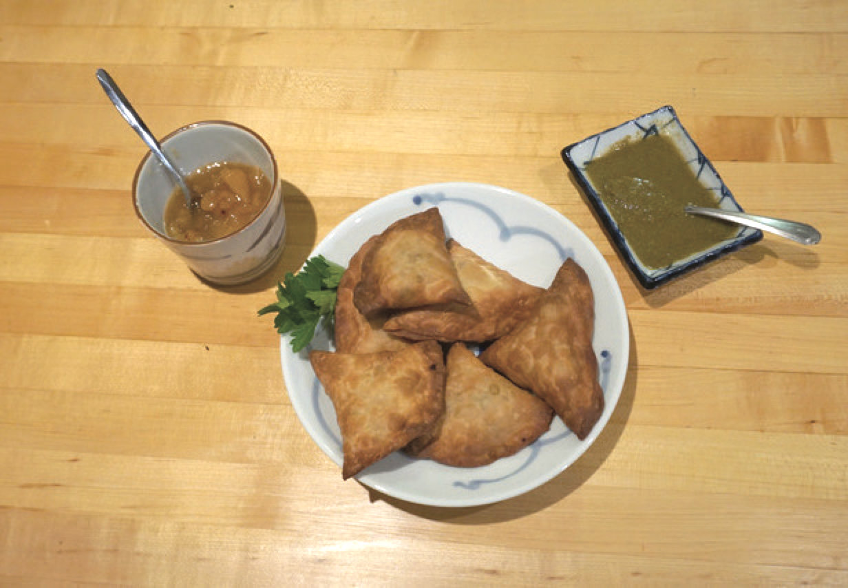 photo of a plate of samosas